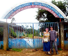 Karen and her nephew, Jared, in front of the school