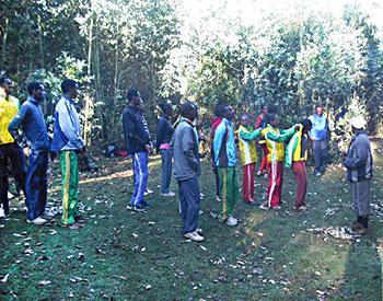 Coach Sentayehu (right) describes the morning drill