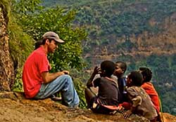 """Sit right down next to me here"" from the video The Volunteers of Ethiopia"