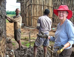 Marian slings chika with a Habitat for Humanity build in Debre Berhan, 2010
