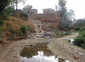The River Assem during the dry season, and the steps up to Medhane Alem Church. The beginning of the lower Museum compound is on the right.
