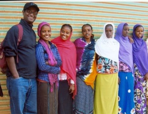 Mega Vision staff member, Teshome, with students in 2011.